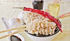 A bowl of noodles - which you can eat at a counter.
