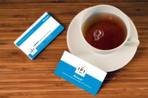Bussiness cards next to a cup of tea - the essentials of Japanese work culture