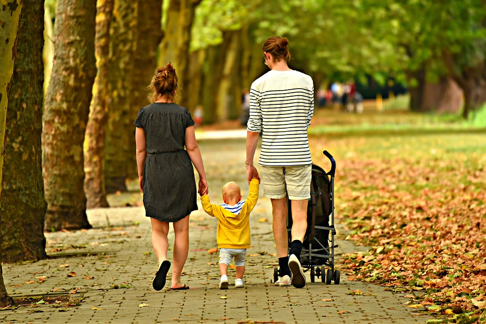 Family with small children walking
