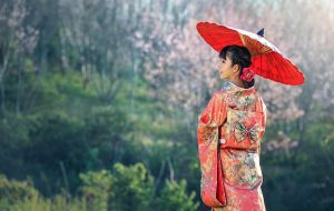 Japanese culture is rich and colorful like this woman in a kimon holding an umbrella, but not everyone can fit in.
