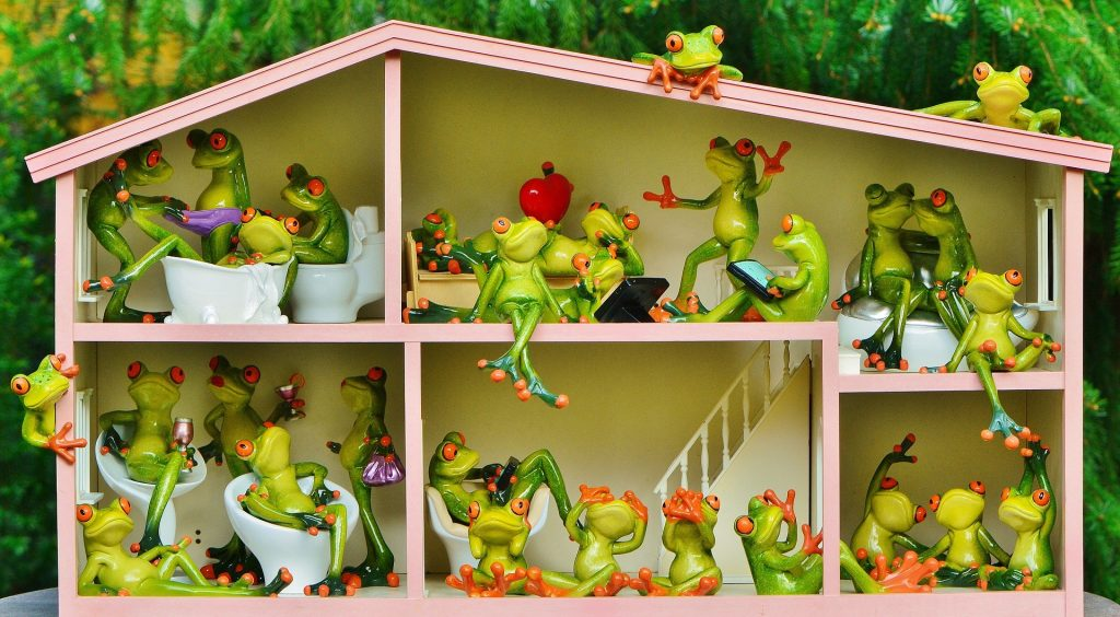 A lot of frog statues - representation of an apartment building.
