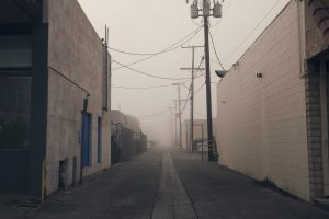 empty street in early morning with fog