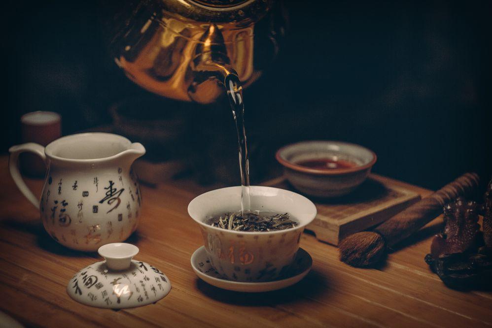 A kettle and a tea set.