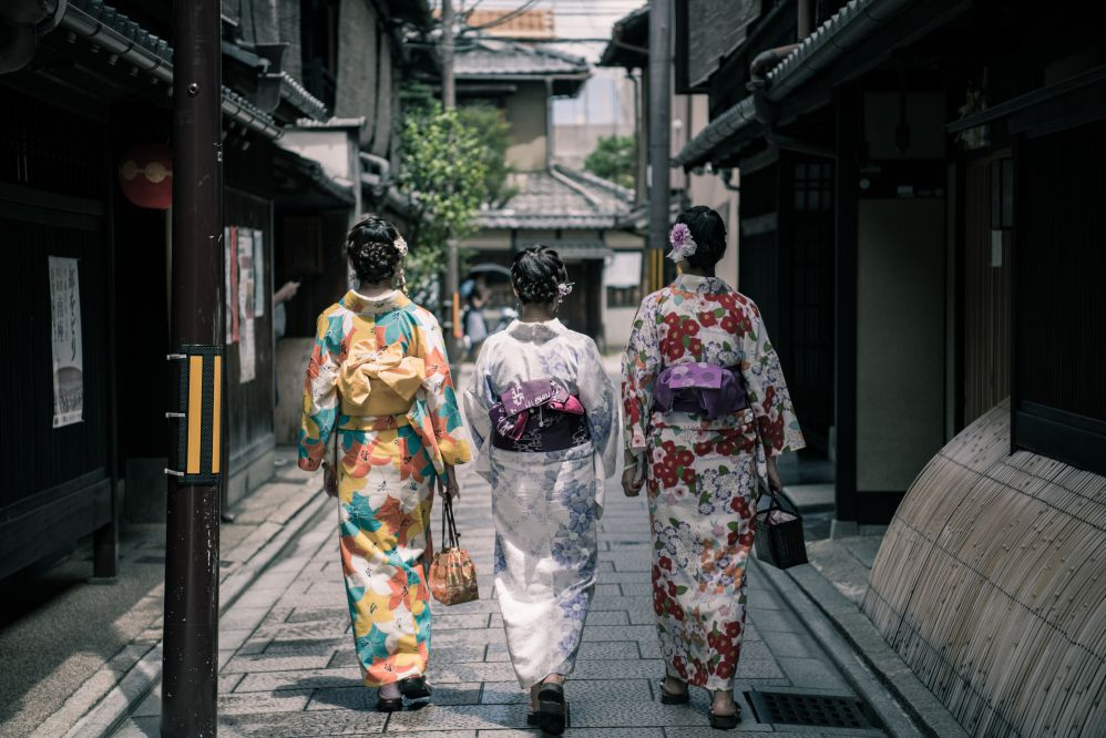 Geisha walking down the street.