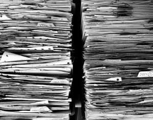 Piles of papers needed for shipping machinery abroad