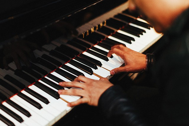 A pianist playing a piano