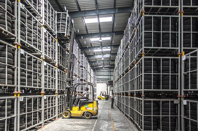 A worker trying to manage warehouse inventory