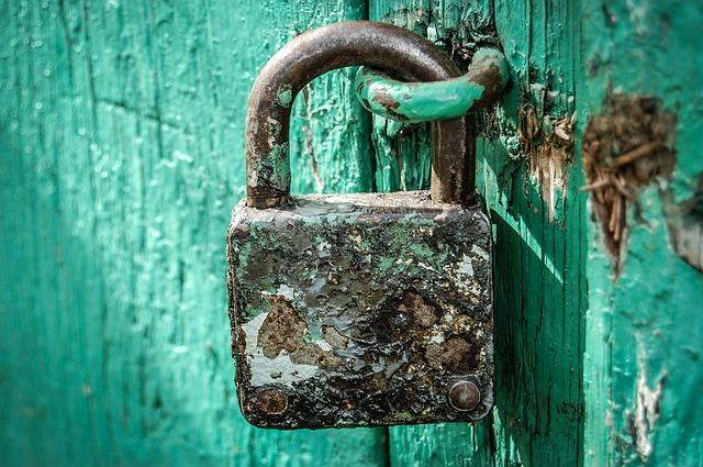 A rusty padlock.