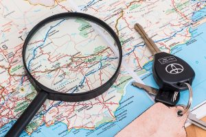 A magnifying glass and a map.