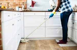 a lady cleaning the kitchen