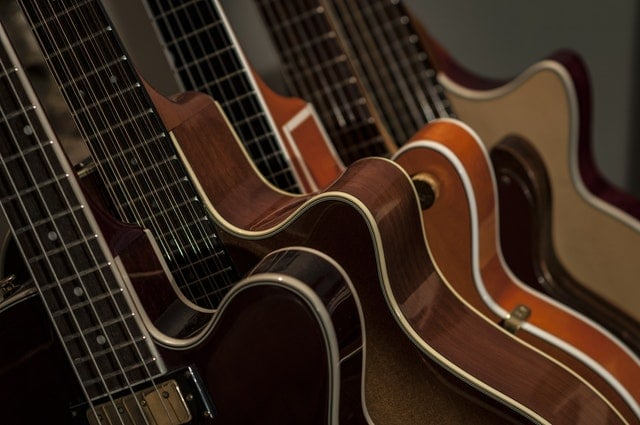 Four brown guitars. Here is how to pack a musical instrument for shipping.