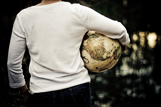 A man holding a globe.