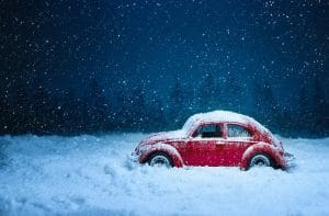 A red car moving to a colder climate