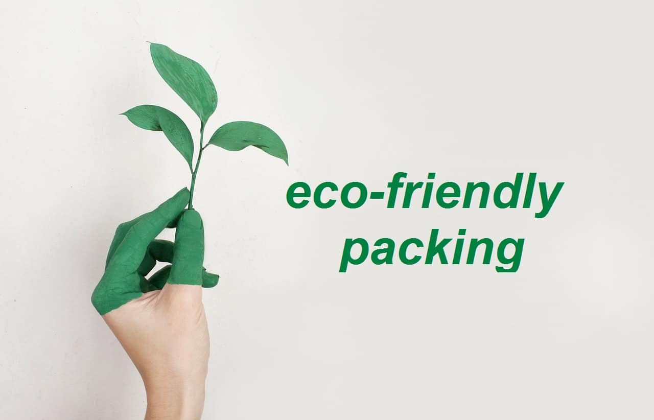A woman holding a leaf and ''eco-friendly packing'' written - we've prepared some eco-friendly overseas moving tips for you