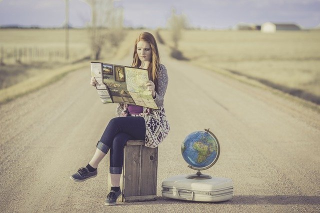 Woman sitting and learning about The challenges of moving to a foreign country
