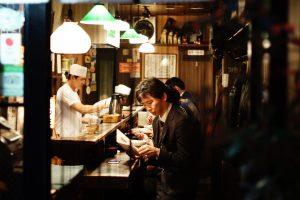 a man sitting in a restaurant