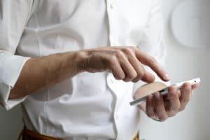 A man dialing his phone