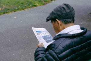 A man reads newspapers