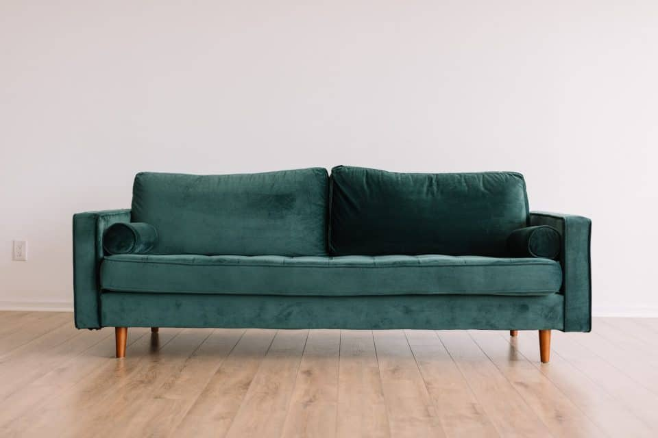 Large sofa that shows why is packing heavy furniture for moving overseas so difficult