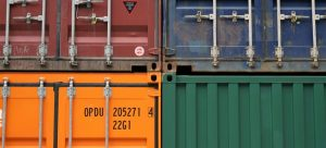 Colorful cargo containers on top of each other.