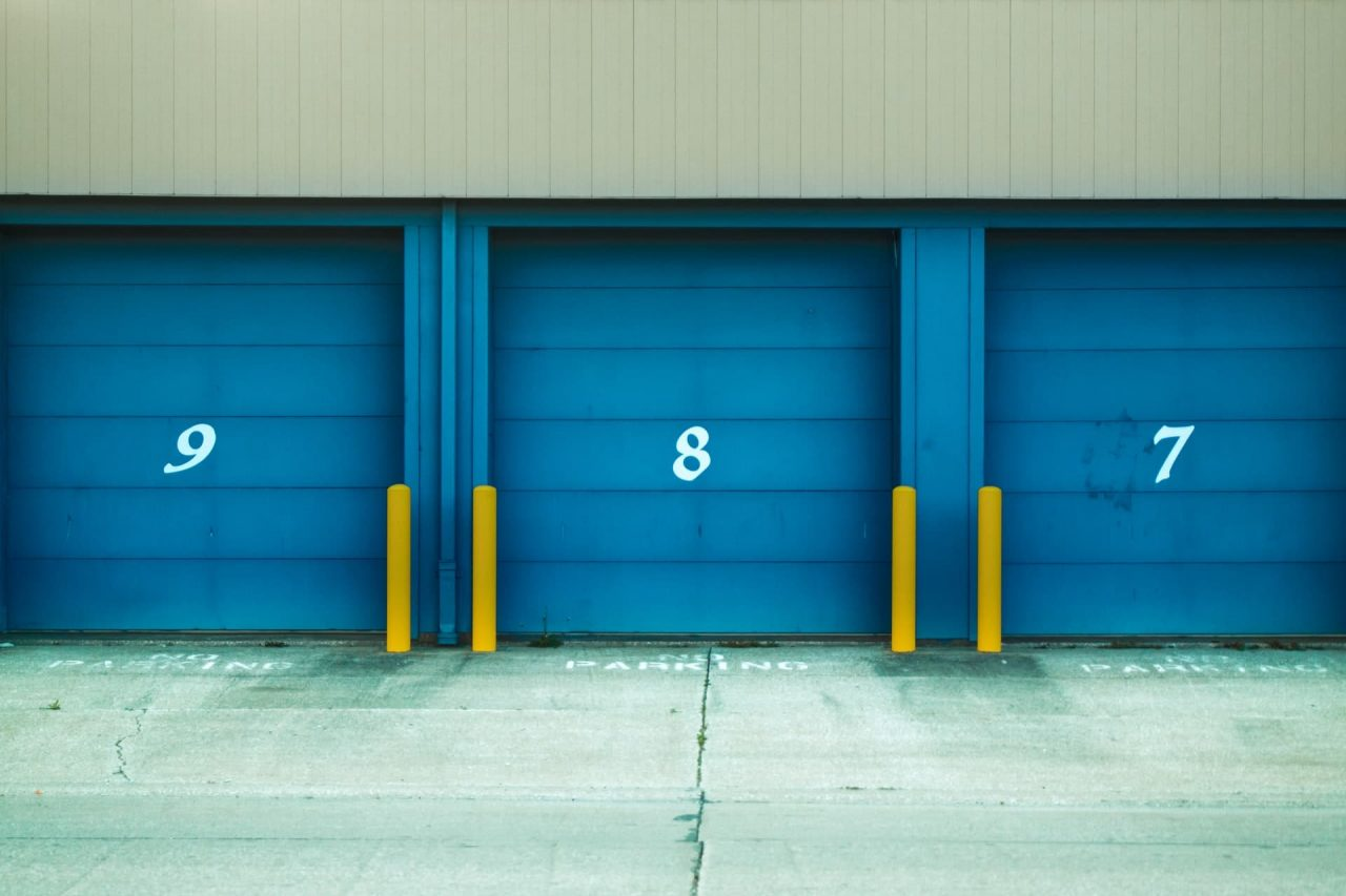 front view of three blue storage unit doors