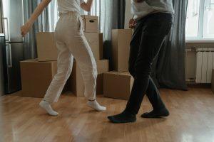 Two people dancing in between carboard boxes