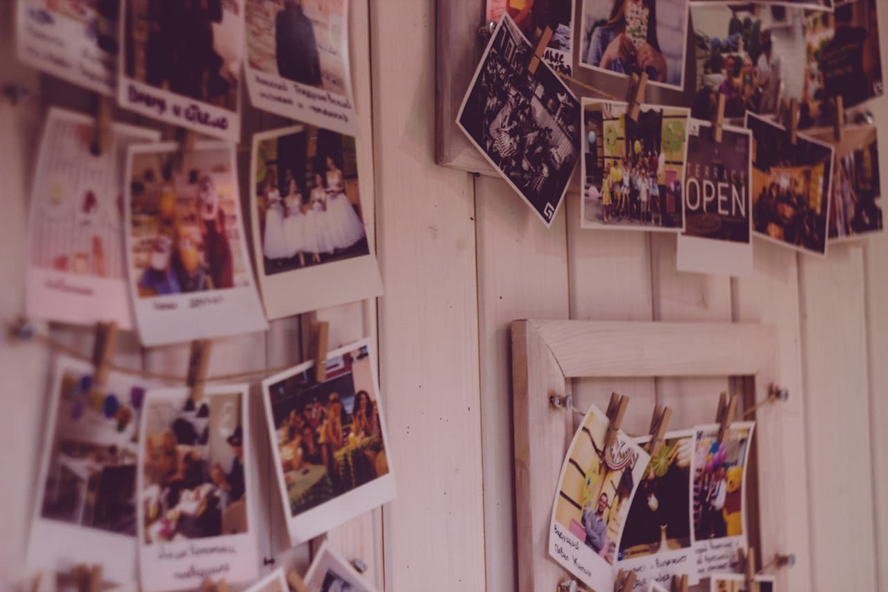 a bunch of photos pinned to the wall